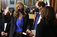 United States Vice President Kamala Harris, right, swears in Samantha Power, administrator of the United States Agency for International Development (USAID), alongside her husband Cass Sunstein, holding the bible, in the Eisenhower Executive Office Building in Washington, D.C., U.S., on Monday, May 3, 2021. The Senate confirmed Power, who was an ambassador to the United Nations during the Obama administration, on April 28. <br /> Credit: Oliver Contreras / Pool via CNP /MediaPunch
