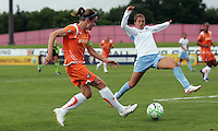 Sky Blue's Heather O'Reilly (9) crosses the ball past the outstretched leg of Chicago's Carli Lloyd (10).  Sky Blue defeated the Chicago Red Stars 1-0 in a mid-week game, Wednesday, June 17, at Yurcak Field.