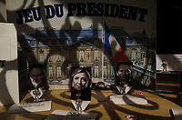 """France. Ile de France. Paris. The """"Presidential Game"""" for sale in a shop window. Figurines with pictures from french presidential election candidates:  Jacques Cheminade for the right-wing party """"Solidarité et progrès"""", Marine Le Pen for the far-right National Front (FN) party, Benoit Hamon for the Socialist party (PS). 21.04.17  © 2017 Didier Ruef"""