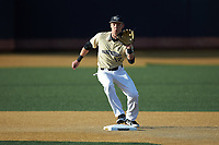 Wake Forest Demon Deacons shortstop Bruce Steel (17) fields a ground ball behind the second base bag during the game against the Liberty Flames at David F. Couch Ballpark on April 25, 2018 in  Winston-Salem, North Carolina.  The Demon Deacons defeated the Flames 8-7.  (Brian Westerholt/Four Seam Images)