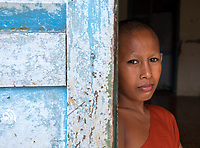 Portrait of Buddhist Monk at an old Monastery in Battambang, Cambodia