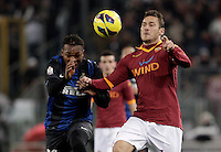 Calcio, semifinale di andata di Coppa Italia: Roma vs Inter. Roma, stadio Olimpico, 23 gennaio 2013..FC Inter midfielder Joel Obi, of Nigeria, and AS Roma forward Francesco Totti, right, fight for the ball during the Italy Cup football semifinal first half match between AS Roma and FC Inter at Rome's Olympic stadium, 23 January 2013..UPDATE IMAGES PRESS/Riccardo De Luca