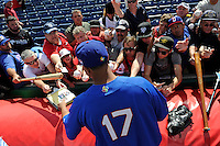 Dominican Republic outfielder Nelson Cruz #17 signs autographs during practice before a Spring Training game against the Philadelphia Phillies at Bright House Field on March 5, 2013 in Clearwater, Florida.  The Dominican defeated Philadelphia 15-2.  (Mike Janes/Four Seam Images)
