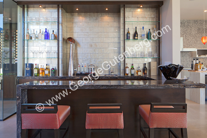 Stock photo of residential wet bar in ultra modern luxury home