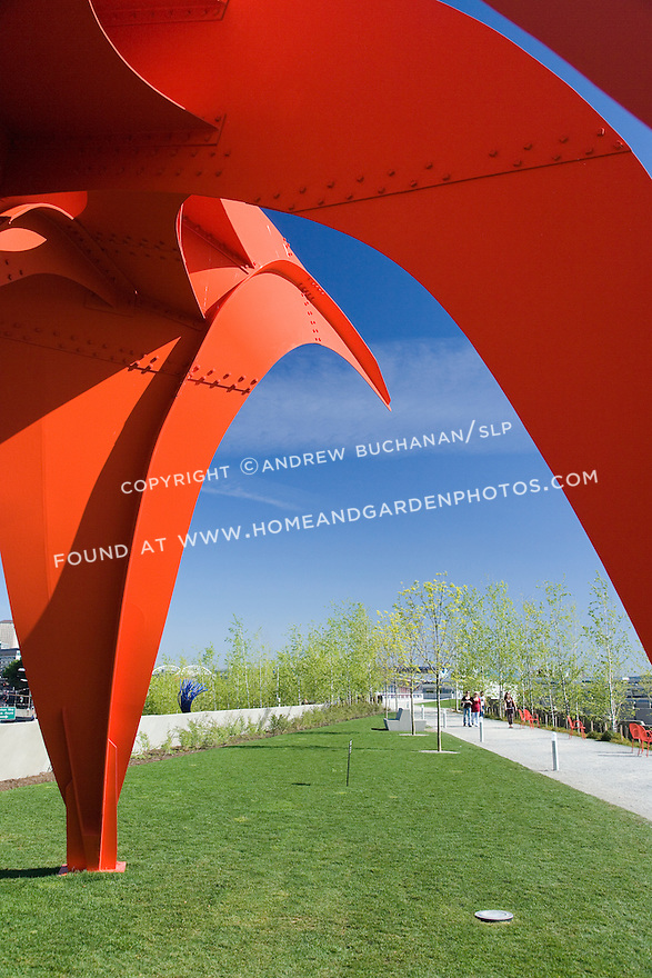 """Seen up close, the vivid red of Alexander Calder's, """"Eagle, 1971"""" contrasts with the vivid blue of a Northwest sky and the fresh gravel of the Moseley Path.   SAM's Olympic Sculpture Park, Seattle, WA."""