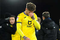 Joe Rodon of Swansea City looks dejected at full time during the Sky Bet Championship match between Fulham and Swansea City at Craven Cottage on February 26, 2020 in London, England. (Photo by Athena Pictures/Getty Images)
