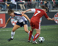 Lauren Cheney, Rhian Wilkinson. The US Women's National Team defeated the Canadian Women's National Team, 4-0, at BMO Field in Toronto during an international friendly soccer match on May 25, 2009.