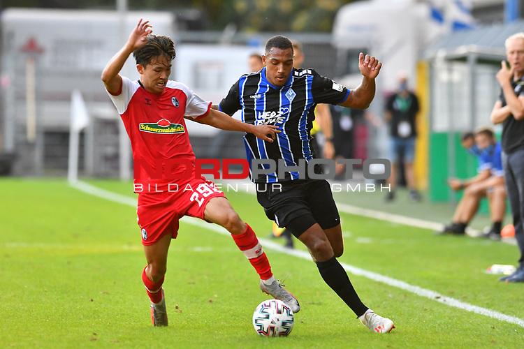 13.09.2020, Carl-Benz-Stadion, Mannheim, GER, DFB-Pokal, 1. Runde, SV Waldhof Mannheim vs. SC Freiburg, <br /> <br /> DFL REGULATIONS PROHIBIT ANY USE OF PHOTOGRAPHS AS IMAGE SEQUENCES AND/OR QUASI-VIDEO.<br /> <br /> im Bild: Anton Donkor (SV Waldhof Mannheim #19) gegen Woo-yeong Jeong (SC Freiburg #29)<br /> <br /> Foto © nordphoto / Fabisch