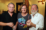 From left: Ben and Caroline Jansen with John Runnels at the art openings of Carter Ernst, Ken Mazzu and Pat Johnson  at the Art Car Museum Saturday June 29, 2013.(Dave Rossman photo)