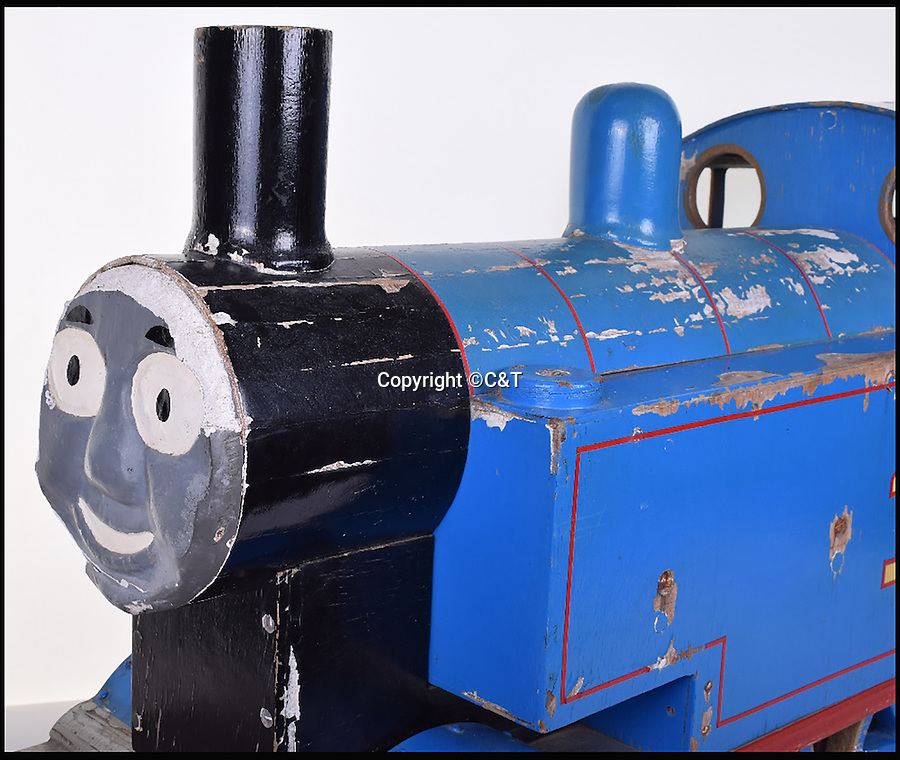 BNPS.co.uk (01202 558833)<br /> Pic: C&T/BNPS<br /> <br /> The large prototype of Thomas the Tank Engine that TV producers based the smaller toy models on for filming the popular children's programme <br /> has come to light.<br /> <br /> The wooden train that is almost one metre long was the first real-life depiction of the distinctive blue steam engine which had previously featured in the books by Reverend Wilbert Audrey.<br /> <br /> It was crafted by David Mitten, who was also the director of Thomas the Tank Engine when it first broadcast on ITV in 1984.<br /> <br /> The prototype is being sold on October 5 at C&T Auctions.