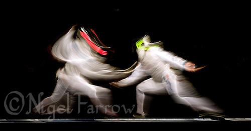 11 AUG 2008 - BEIJING, CHN - Margherita Granbassi (ITA) v Giovanna Trillini (ITA) - Womens Individual Foil  - Day Three - Beijing Olympics. (PHOTO (C) NIGEL FARROW) *** IOC RULES APPLY ON USAGE ***