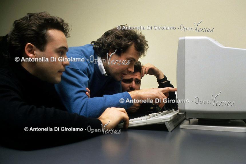 """Istituto Tecnico Industriale Statale """"G. Armellini"""". Studenti adulti durante i corsi serali per lavoratori. Laboratorio di informatica..Industrial technical school, Rome. Adult students at evening classes for workers. Computer science laboratory...."""