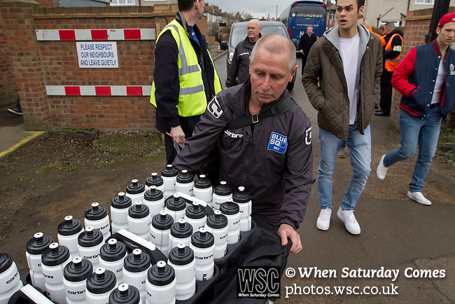 Wealdstone 0 Newport County 0, 17/03/2012. St Georges Stadium, FA Trophy Semi Final. A member of the visiting back room staff pushing items of kit towards St Georges Stadium, home ground of Wealdstone FC, before the club played host to Newport County in the semi-final second leg of the F.A. Trophy. The game ended in a goalless draw, watched by a capacity crowd of 2,092 which meant the visitors from Wales progressed by three goals to one to the competition's final at Wembley, where they would meet York City. The F.A. Trophy was the premier cup competition for non-League clubs in England and Wales affiliated to the Football Association. Photo by Colin McPherson.