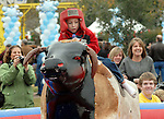 David Lewis,7, rides the mechanical bull at the Lanier Law Firm's Holiday Bash Sunday Dec. 13,2009.(Dave Rossman/For the Chronicle)