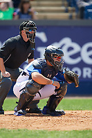 Umpire Ben Phillips and Wilmington Blue Rocks catcher Chase Vallot (13) during the first game of a doubleheader against the Frederick Keys on May 14, 2017 at Daniel S. Frawley Stadium in Wilmington, Delaware.  Wilmington defeated Frederick 10-2.  (Mike Janes/Four Seam Images)