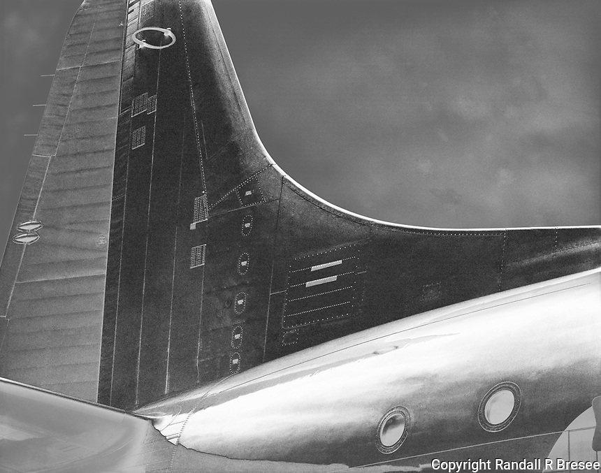 """""""P3-Orion Tail""""<br /> 2012 Salute to Veterans Airshow, Columbia, Missouri<br /> <br /> This photograph shows the rear section of a P3 Orion aircraft. The aircraft was shown at the 2012 Memorial Day """"Salute to Veterans"""" airshow in Columbia, Missouri, where it was photographed."""