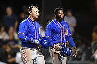 St. Lucie Mets Michael Conforto (left) and Champ Stuart (right) walk back to the dugout after a home run during a game against the Bradenton Marauders on April 11, 2015 at McKechnie Field in Bradenton, Florida.  St. Lucie defeated Bradenton 3-2.  (Mike Janes/Four Seam Images)