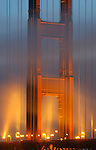 The cooling fog enter under the Golden Gate Bridge in the twlight hours and dance with the lights of the north tower.