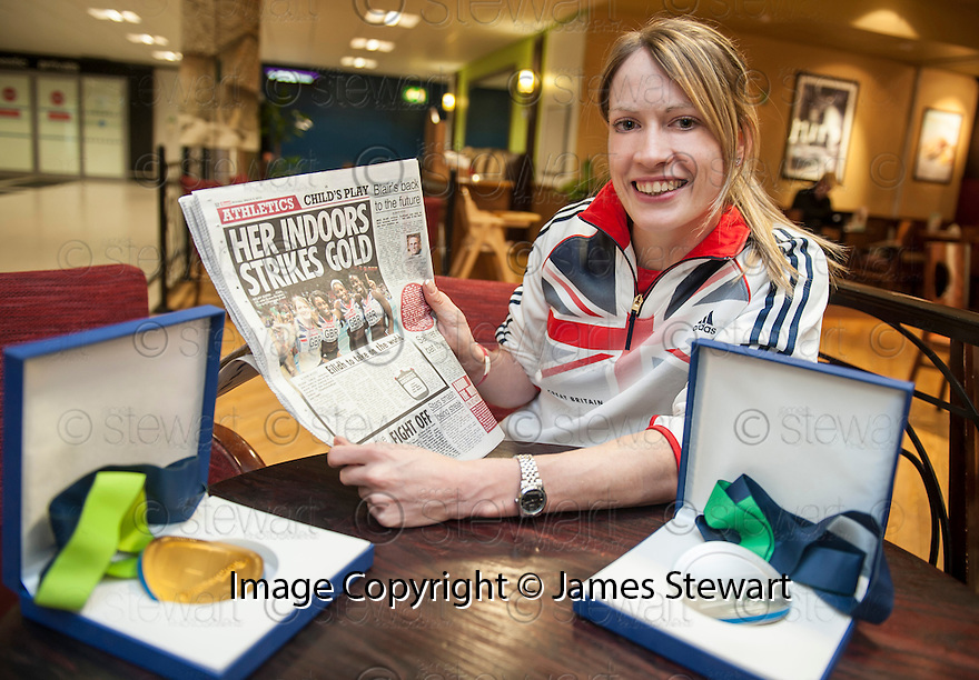 Scots athlete Eilidh Child, catches up with the news of her double medal performance at the European Indoor Championships in Gothenburg as she returns to Edinburgh Airport.