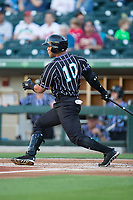 Yoan Moncada (10) of the Charlotte Knights follows through on his swing against the Norfolk Tides at BB&T BallPark on May 2, 2017 in Charlotte, North Carolina.  The Knights defeated the Tides 8-3.  (Brian Westerholt/Four Seam Images)