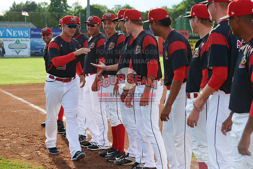 Batavia Muckdogs manager Mike Jacobs (28) greets his team during introductions before a game against the Auburn Doubledays on June 19, 2017 at Dwyer Stadium in Batavia, New York.  Batavia defeated Auburn 8-2 in both teams opening game of the season.  (Mike Janes/Four Seam Images)