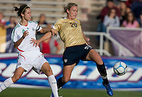 Abby Wambach tries to bring down a pass in front of Mexico's Monica Gonzalez..International friendly, USA Women vs Mexico, Albuquerque, NM,.October 20, 2006.