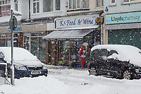 A Father Christmas walks through the village giving cheer to walkers and shopkeepers<br /> Weather - the Snowfall in High Wycombe, England on 10 December 2017. Photo by Andy Rowland.