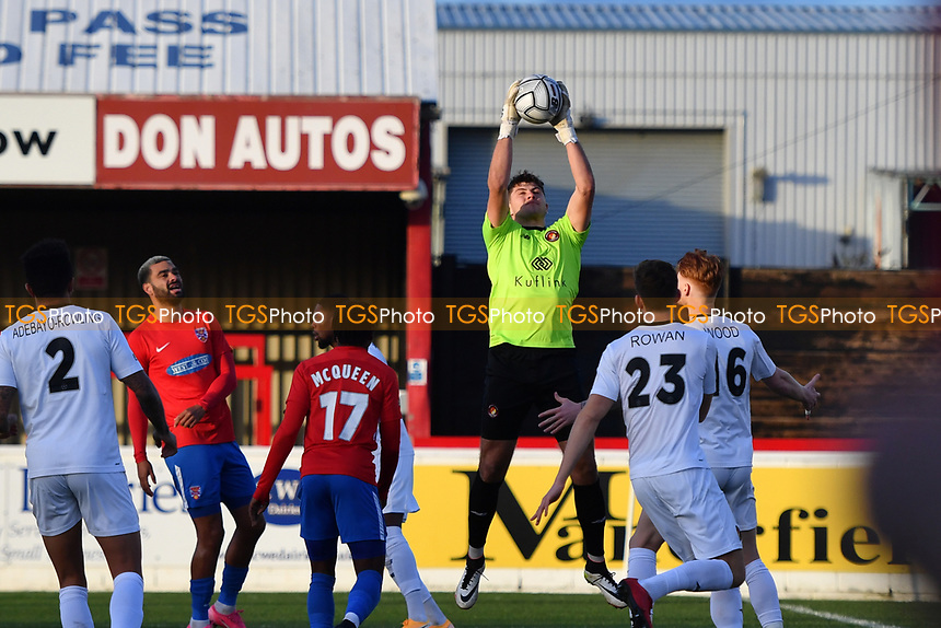 Tom Hadler of Ebbsfleet Town FC  jumps and catches a cross during Dagenham & Redbridge vs Ebbsfleet United, Buildbase FA Trophy Football at the Chigwell Construction Stadium on 19th December 2020