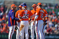 Clemson Tigers pitching coach Dan Pepicelli #24 discusses the situation with Matthew Crownover #44, Tyler Krieger #18, Steve Wilkerson #17 and Jon McGibbon #12 during a game against the South Carolina Gamecocks at Fluor Field on March 1, 2014 in Greenville, South Carolina. The Gamecocks defeated the Tigers 10-2. (Tony Farlow/Four Seam Images)