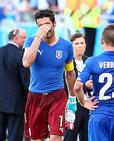 Italy goalkeeper Gianluigi Buffon shows a look of dejection at full time following elimination from the World Cup