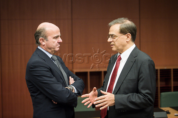 Spanish Economy Minister Luis de Guindos  (L) talks with Greek Finance Minister Gikas Chardouvelis  at the start of a Eurogroup with European Finance Ministers meeting at EU council headquarters in Brussels, Belgium on 26.01.2015 The Eurogroup's meeting focus on Greece, after  leftist anti-bailout party SYRIZA won parliamentary elections by Wiktor Dabkowski
