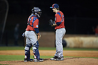 NJIT Highlanders catcher Edgar Badaraco (28) chats with starting pitcher Sean Lubreski (17) during the game against the High Point Panthers at Williard Stadium on February 18, 2017 in High Point, North Carolina. The Highlanders defeated the Panthers 4-2 in game two of a double-header. (Brian Westerholt/Four Seam Images)