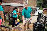 """Members work at the Hawthorne Center for Working Families during """"Circle the City with Service,"""" the Kiwanis Circle K International's 2015 Large Scale Service Project, on Wednesday, June 24, 2015, in Indianapolis. (Photo by James Brosher)"""
