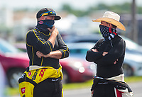 Jul 12, 2020; Clermont, Indiana, USA; NHRA top fuel driver Shawn Langdon (left) talks Wirth Steve Torrence during the E3 Spark Plugs Nationals at Lucas Oil Raceway. This is the first race back for NHRA since the start of the COVID-19 global pandemic. Mandatory Credit: Mark J. Rebilas-USA TODAY Sports