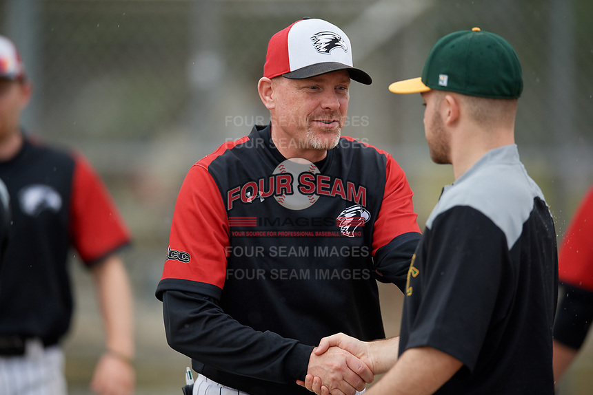Edgewood Eagles Al Brisack shakes hands after a game against the South Vermont Mountaineers on March 18, 2019 at Lee County Player Development Complex in Fort Myers, Florida.  South Vermont defeated Edgewood 19-6.  (Mike Janes/Four Seam Images)