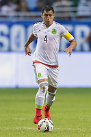 Mexico's defender Julio Cesar Dominguez (4) during an international friendly at the Alamodome, Wednesday, April 15, 2015 in San Antonio, Tex. USA defeated Mexico 2-0. (Mo Khursheed/TFV Media via AP Images)