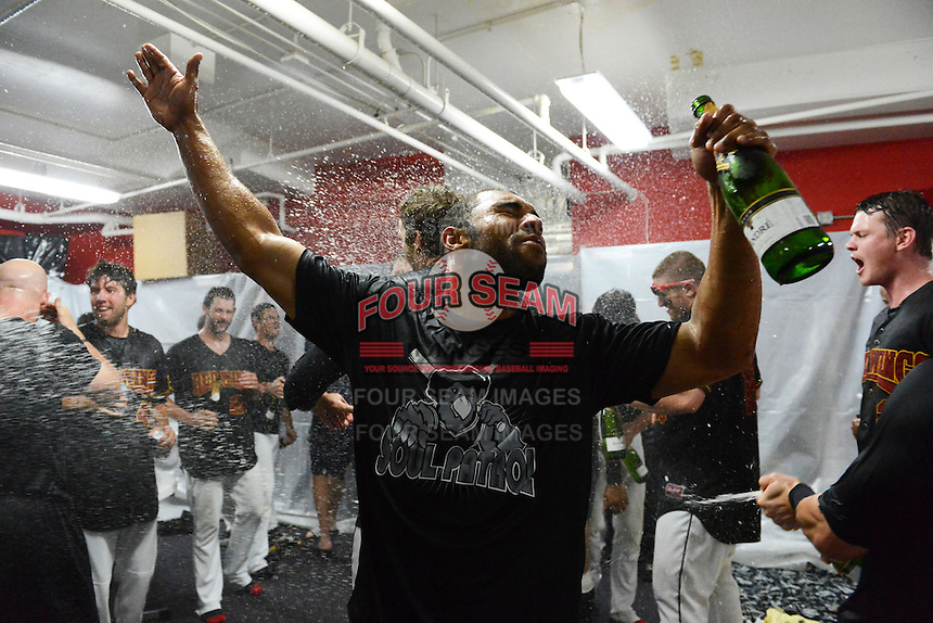 Rochester Red Wings outfielder Jermaine Mitchell celebrates in the locker room after defeating the Scranton Wilkes Barre RailRiders on September 2, 2013 at Frontier Field in Rochester, New York to clinch the International League Wild Card Playoff spot.  (Mike Janes/Four Seam Images)