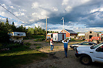 Rancher Carmen Langer and his brother-in-law Doug Dallyn walk towards the air testing shed, middle, which is being monitored by Alberta Environment at Mr. Langer's home near Peace River, Alberta on July 14, 2010. Residents in the area have been complaining of strong odours in the air which they say are affecting the health of their animals and family members..Jimmy Jeong / www.jimmyshoots.com