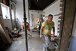 Stockport Pre-Season Training, 09/07/2008. Manor Farm, Timperley, League One. Builders working at the Stockport County's Edgeley Park ground in Stockport, Cheshire where renovation work is taking place in the dressing rooms under the old main stand. The home and away dressing rooms are to be swapped around as a result of the work. County were promoted up to league One following a play-off final victory over Rochdale at Wembley in May, 2008. Jim Gannon took over as manager of the club in 2006 and lead them to promotion after three seasons in League Two. Photo by Colin McPherson.