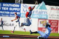 Williamsport Crosscutters shortstop Angelo Mora #2 can not get the throw as Jesus Vasquez #44 slides in during a game against the Jamestown Jammers on June 20, 2013 at Russell Diethrick Park in Jamestown, New York.  Jamestown defeated Williamsport 12-6.  (Mike Janes/Four Seam Images)