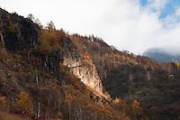 Autumn cliff and foliage near Fudou no Taki, Nagano, Japan.