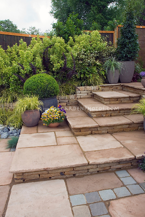 Tiered patio with mixed paving materials. Design by Geoff Whiten
