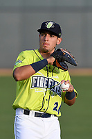 Shortstop Jeremy Vasquez (20) of the Columbia Fireflies warms up prior to a game against the Augusta GreenJackets on Friday, April 6, 2018, at Spirit Communications Park in Columbia, South Carolina. Columbia won, 7-2. (Tom Priddy/Four Seam Images)
