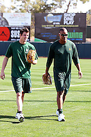 Grant Green #57 (left) and Michael Taylor #23 (right) of the Oakland Athletics participates in spring training workouts at the Athletics complex on February 16, 2011  in Phoenix, Arizona. .Photo by:  Bill Mitchell/Four Seam Images.