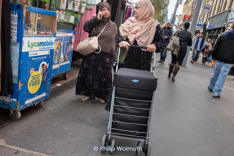Women shopping in Whitechapel Market, London.