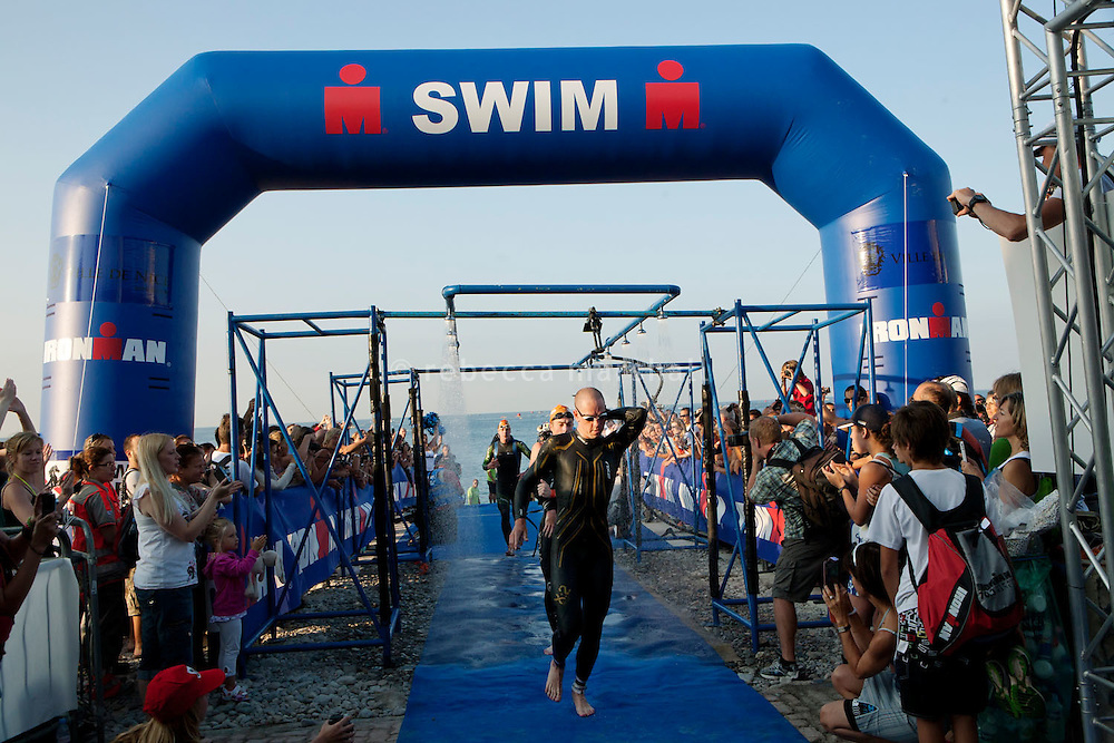 Frederik Van Lierde is the first triathlete out of the water at Ironman France 2012, Nice, France, 24 June 2012