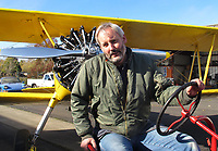 Pilot and aircraft mechanic Bryan Turner tows his Stearman PT-17 from his hangar with his Farmall Tractor at the Petaluma Municipal Airport, Petaluma, Sonoma County, California.