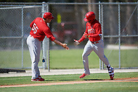 GCL Cardinals left fielder Angel Moreno (50) is congratulated by manager Erick Almonte (55) as he rounds third base after hitting a home run in the bottom of the first inning during a game against the GCL Nationals on August 5, 2018 at Roger Dean Chevrolet Stadium in Jupiter, Florida.  GCL Cardinals defeated GCL Nationals 17-7.  (Mike Janes/Four Seam Images)
