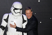 Alan Tudyk poses with a Stormtrooper during the STAR WARS: 'The Force Awakens' EUROPEAN PREMIERE at Odeon, Empire & Vue Cinemas, Leicester Square, England on 16 December 2015. Photo by David Horn / PRiME Media Images