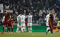 Juventus' players, at center, celebrate as Roma's players react at the end of the Italian Serie A football match between Juventus and Roma at Juventus Stadium. Juventus won 1-0.